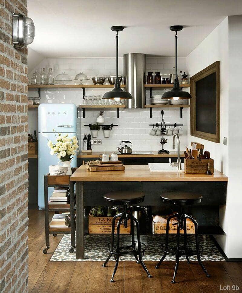 cocina estilo industrial pequeña con barra