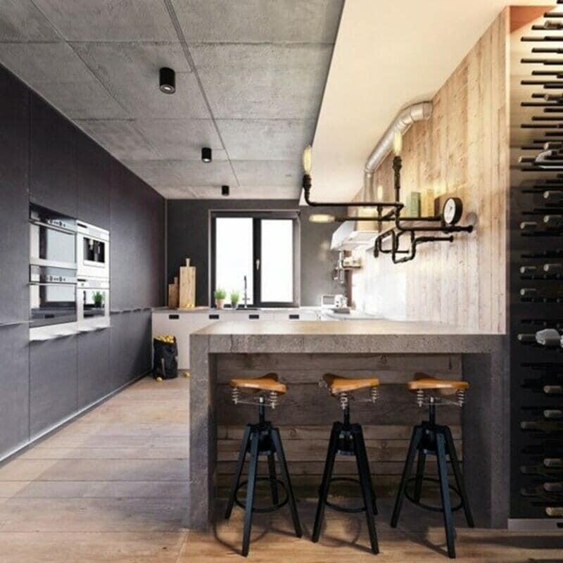 cocina estilo industrial con bar de cemento
