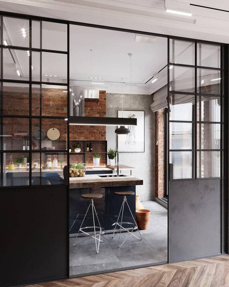 cocina estilo industrial con mampara divisoria de metal y cristal