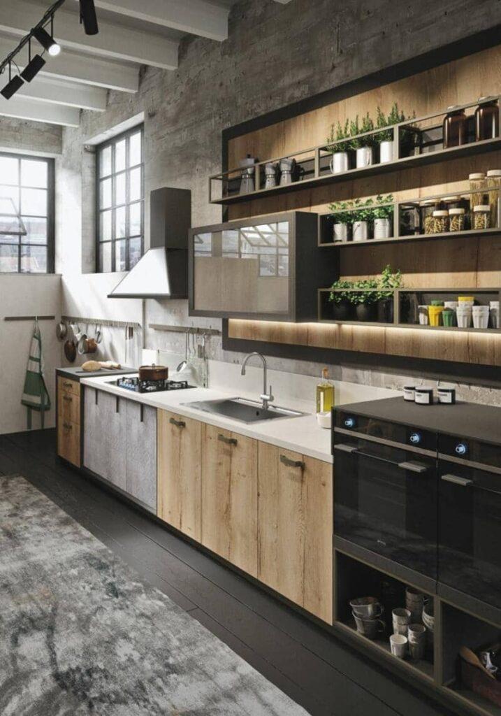 cocina estilo industrial con pared de cemento y madera